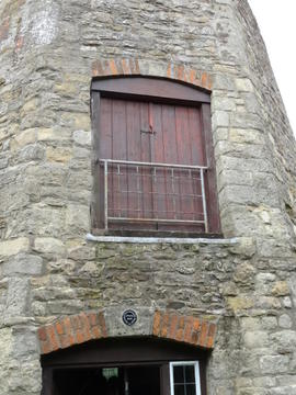 External view of tower showing loading door, Littleworth Mill, Wheatley
