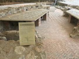 Ruins of Roman villa with sign about milling