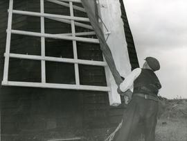 Securing sail cloth at Herringfleet Smock Mill, Suffolk