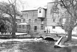 Building and water courses with children posed, Old Mill, Bexley
