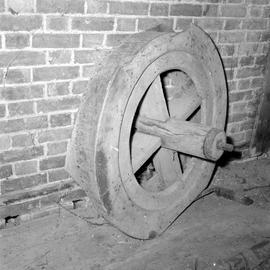 Detail of four-spoked wheel, possibly part of a belt drive, Barcombe Farm, Alton Pancras