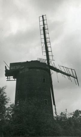 Tower mill, Old Buckenham, derelict, with broken sails