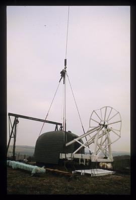 Cap and fan on ground attached to hook of crane, Waterhall Mill, Patcham