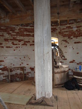 View of stone floor showing upright shaft, tower mill, Caston