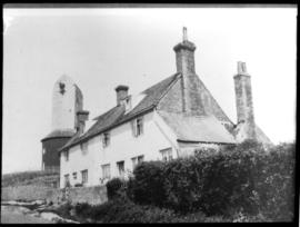 Boreham Street Mill, Wartling, with no sails or sweeps, behind houses