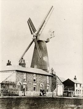 Tower mill, Rodmersham Green, in working order with man standing on reefing stage