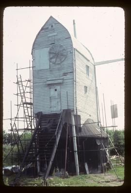 Jill Mill, Clayton, scaffolded for repair, with stocks