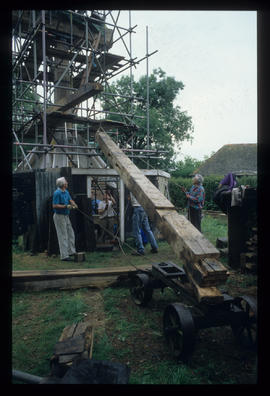 Workers pulling their weight lifting buck timber into new buck, Oldland Mill, Keymer
