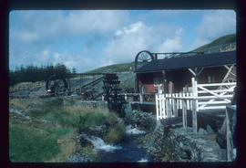 Various standalone waterwheels for different purposes, preserved in open air