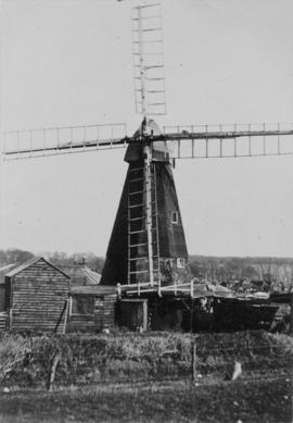 Front view of Mill with sheds to front left