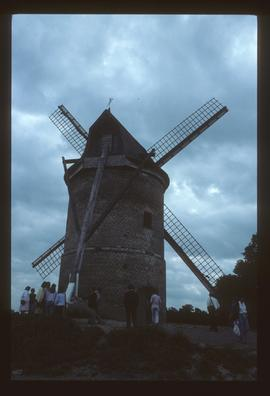 Preserved tower mill, parallel-sided with sails and tailpole