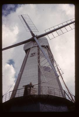 Man using pole to turn sails, Union Mill, Cranbrook