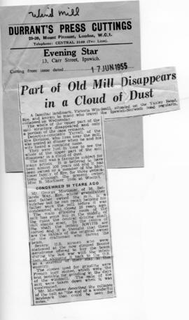 """Part of old mill disappears in a cloud of dust"""