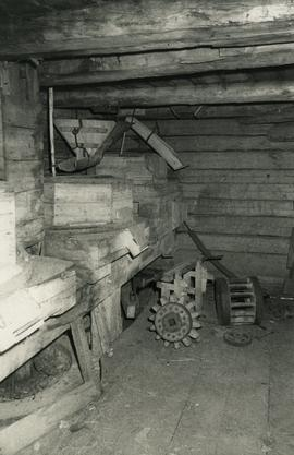 Stones, saw clamp, nut and wallower pinion inside a magpie mill on Luhtas-Köykkä farm in Luopajär...