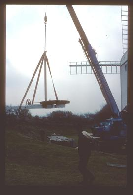 Winding gear and new fan carriage being lifted off ground by crane, Jill Mill, Clayton
