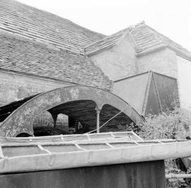 Blashenwell Farm Wheel, Corfe Castle, showing the waterwheel and side of the mill