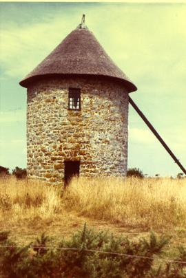 Preserved (sails, and apparently windshaft, missing) tower mill, Brittany, France, summer 1970