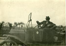 Harry Branford Holman in his car