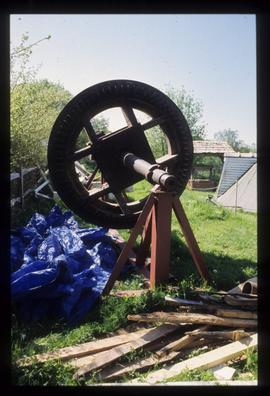Brakewheel and windshaft of smock mill under repair on ground, King's Mill, Shipley