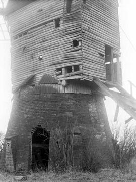 Post mill, Costock, showing brick base and part of wooden superstructure