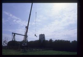 Man being lifted up by crane, Waterhall Mill, Patcham