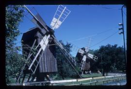Pair of preserved open-trestle post mills with sails