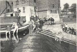 Scouts pulling a boat over the wier by Tadcaster Mill