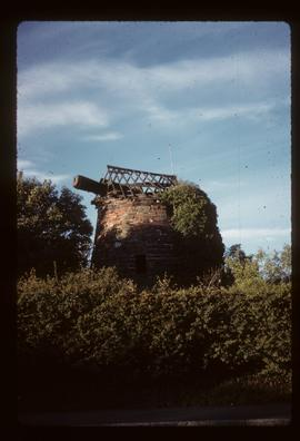 Tower mill, Gayton, Merseyside, derelict, with windshaft and cap roof framing