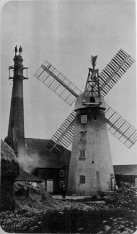 Adjacent tall chimney with workmen on top, tower mill, Saxilby