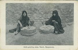 Arabs grinding corn, Basrah, Mesopotamia