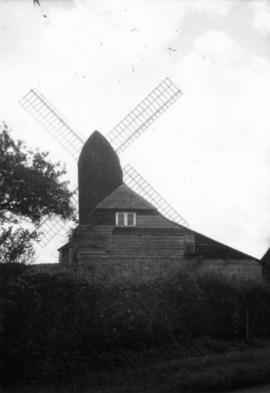 Post mill, Rolvenden, partly obscured by house