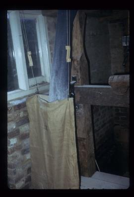 Chute with sack for collecting flour, Batemans Mill, Burwash
