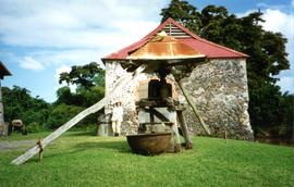 Photograph of a two-roll vertical mill, Maison de la Canne, Trois Ilets, Martinique