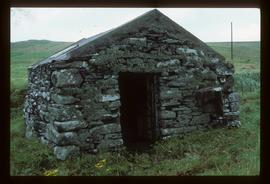 Small unidentified stone building, presumably watermill, in coastal setting