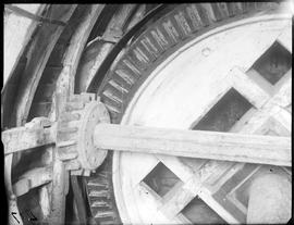Skew gear behind brake wheel driving a cross-shaft inside post mill