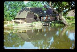 Exterior of house-converted watermill building with millpond