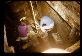 Volunteers/enthusiasts at work inside unidentified watermill