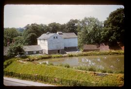 Preserved watermill building, still in use as business, by millpond