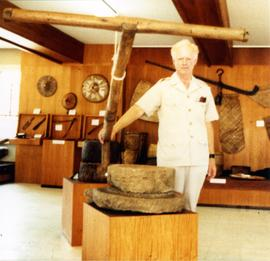 Photograph of Niall Roberts with a t-pole drive to troughed quern, Philippines