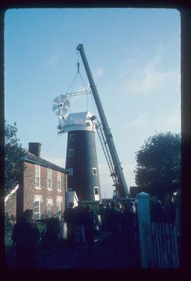 Cap being lifted into place by crane, High Street Mill, Wicklewood
