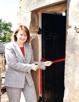 Kathy Rochford cuts tape to formally open Heage Tower Mill