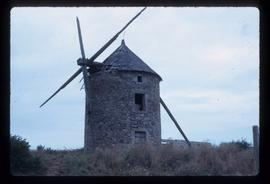 Derelict tower mill with stocks and remains of one sail