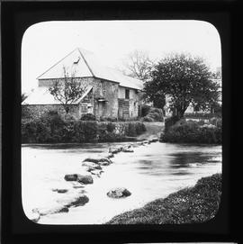 Stone watermill building by stream
