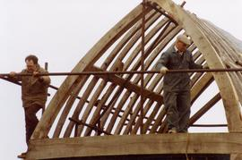 Two volunteers working on buck scaffolding, post mill, Chinnor