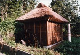 Photograph of a rice mill hut, Japan