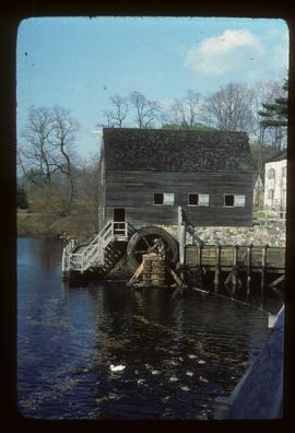Exterior view of preserved watermill building with wheel, New York, Tarrytown, Philipsburg Manor