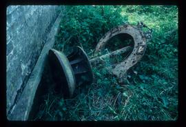 Remains of water turbine on ground