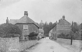 Copy of nineteenth century photograph showing general view along village street