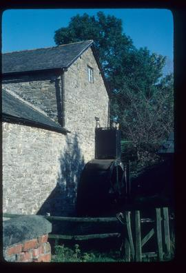 Exterior of watermill building with wheel