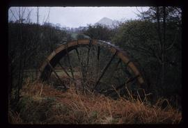 Exterior view of stand-alone iron waterwheel